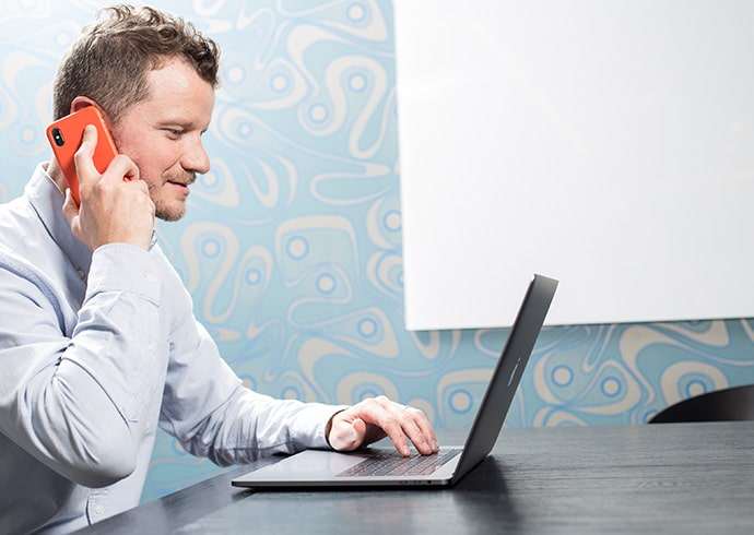 Man Interacting with Intelligent Virtual Assistant Personalization